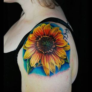 Color realism sunflower tattoo by Justin Buduo. #realism #colorrealism #JustinBuduo #flower #sunflower