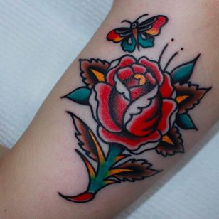 Classic and solid rose with butterfly. Tattoo by CP Martin. #CPMartin #thedarlingparlour #sydney #traditionaltattoos #rose #butterfly