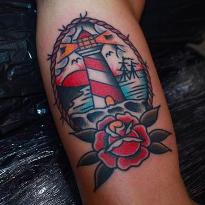 A lighthouse above a nautical rose by CP Martin (IG—cpmartintattoo). #CPMartin #lighthouse #rose #seascape #traditional