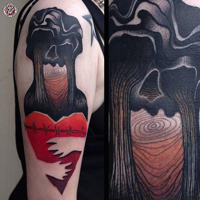 Black and red semi-abstract tattoo by Łukasz Sokołowski. #LukaszSokolowski #semiabstract #blackandred #abstract #graphic #conceptual #heart