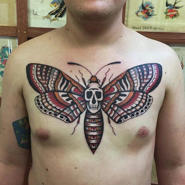 A deathly moth tattoo via Tommy Doom (IG—tommydoom). #moth #skull #TommyDoom #traditional