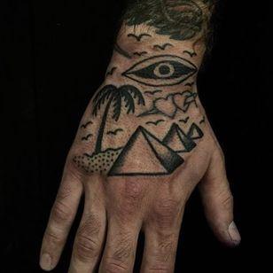 Hand landscape tattoo by Will Sheldon #WillSheldon #landscapetattoo #blackwork #pyramid #palmtree #tree #desert #egypt #allseeingeye #dotwork #linework #birds #eye #tattoooftheday