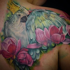 Cockatoo and flower back piece. Tattoo by Maija Arminen. #realism #colorrealism #MaijaArminen #cockatoo #bird #flower