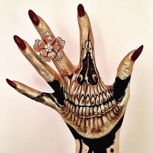 A detailed, golden skull hand, make-up and design by Vanessa Davis. (via IG—the_wigs_and_makeup_manager) #Makeup #Halloween #Beauty #MACMakeup #Art #MUA