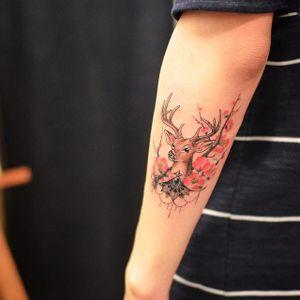 Deer tattoo by Grain. #Grain #TattooistGrain #fineline #animals #deer #stag #jewel #cherryblossom #flowers