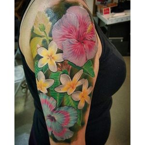 Color realism frangipani and hibiscus tattoo half sleeve by Andy Nava. #realism #colorrealism #flower #frangipani #hibiscus #AndyNava