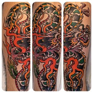Classic and solid looking dragon with flames. Beautiful work by Jason Brooks. #JasonBrooks #GreatWaveTattoo #boldtattoos #TraditionalTattoo #dragon #firedragon #flames