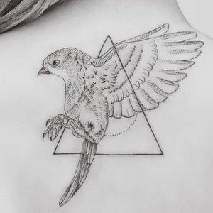 Flying through the triangle. Tattoo by Jasper Andres. #JasperAndres #geometry #nature #bird #triangle