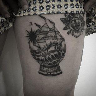 Ship in a snow globe tattoo by Jamie Eddy. #snowglobe #glass #blackandgrey