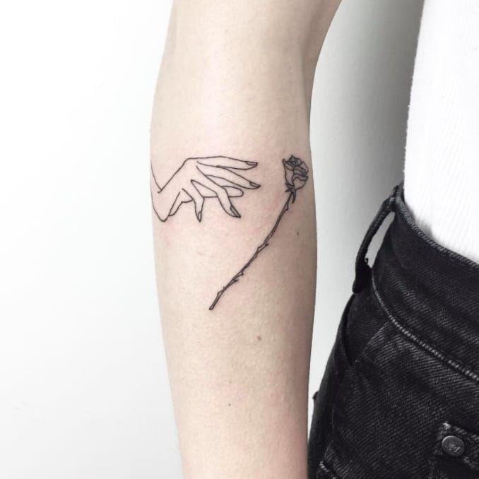 Hand and rose tattoo by Cagri Durmaz #CagriDurmaz #drawing #doodle #sketch #sketchbook #blackworkers #linework #blackwork #smalltattoo #littletatto #minimalist #rose #rosetattoo #linework #micro