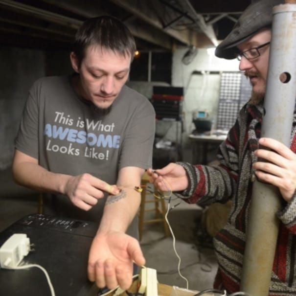 Pictured, Tim Cannon and Shawn Sarver in the basement workshop of Grindhouse Wetware. (Photo by Andrew Russell for Tribune-Review) #cyborg #bodymodifications #biohacking #science #diy #bodymods #implants #grindhouse