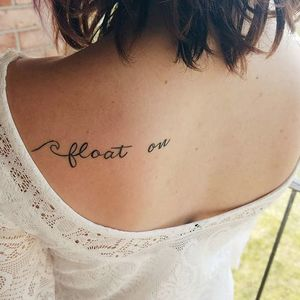 Float On in fancy script on someone's back. (via IG—maidmariane) #PlayItAgain #FloatOn #ModestMouse #MusicTattoo #LyricsTattoo