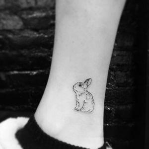 Bunny linework tattoo by Evan. #bunny #rabbit #cute #subtle #microtattoo #bunnytattoo #blackwork #linework