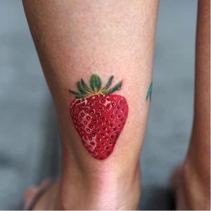 Strawberry by @joicewang.nyc #tinytattoo #tiny #smalltattoo #strawberry #fruit #delicious #JoiceWang #colorrealism #realism #food