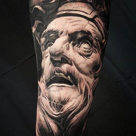 A statuesque tattoo by Chris Mata'afa (IG—chris_showstoppr). #blackandgrey #ChrisMataafa #realism #statue