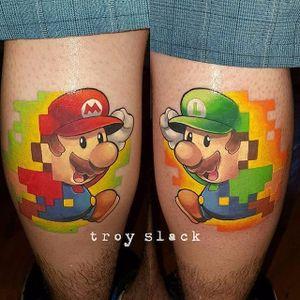 Luigi and Mario tattoo by Troy Slack. #TroySlack #supermario #videogame #pixel