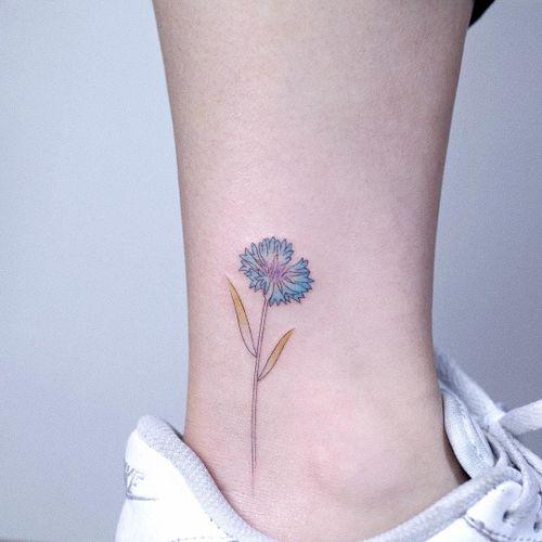 Cute flower by Tattooist Arar #TattooistArar #watercolortattoos #color #painterly #watercolor #flower #floral #nature #plant #leaves #minimal #small #fineline #illustrative