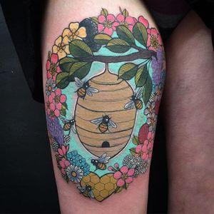 Sweet bee hive and flowers tattoo by Charlotte Timmmons. #neotraditional #bees #hive #beehive #flowers #CharlotteTimmons