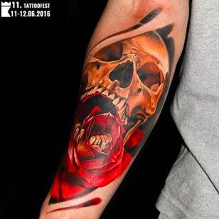 Skull rose tattoo by Levgen Knysh that won 1st place Best of Sunday at Tattoofest. Photo taken from Instagram @tattoofestconvention #Krakow #TattooFest #Poland #rose #skull #realism