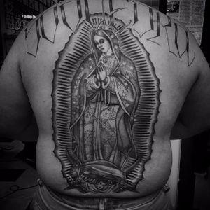 Sick back piece by Chuco Moreno #ChucoMoreno #oldschool #blackandgrey #religious #christian #VirginMary #Madonna #OurLadyOfGuadalupe #light #crown #prayer #angel #cherub #text #font #tattoooftheday