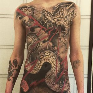 Epic torso piece. (via IG - joaobosco) #snaketattoo #torsotattoo #joaobosco
