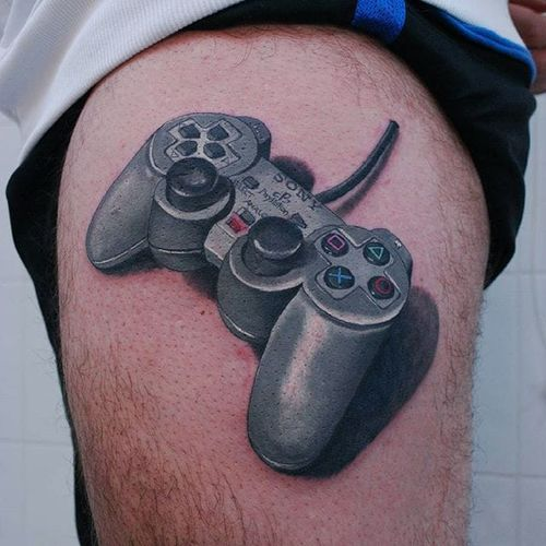 PlayStation-inspired tattoo by Stefano Gollinelli. #colorrealism #realistic #playstation #sony #nostalgia #videogames #retro #childhood #controller