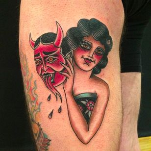 A solid tattoo of a girl rockin' a demon mask, tattoo by Anem. #Anem #traditionaltattoo #girl #girltattoo #demon #traditional #traditionalgirl