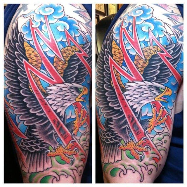 Amazing action packed eagle tattoo done by Jason Brooks. #JasonBrooks #GreatWaveTattoo #boldtattoos #TraditionalTattoo #eagle #redlightning