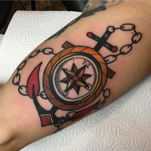 A compass at an anchor's center by Adam Cornish (IG—adamcornishtattooer). #AdamCornish #anchor #compass #traditional