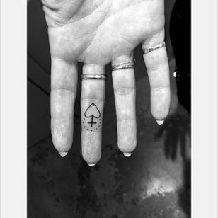 Mini sacred heart finger tattoo by Daniel Winter. #singleneedle #fineline #linework #DanielWinter #sacredheart