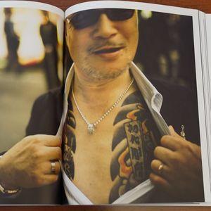A Yakuza member showing off some of his tattoos from Anton Kusters' Odo Yakuza Tokyo. #AntonKusters #Japan #Irezumi #OdoYakuzaTokyo #photography #Yakuza