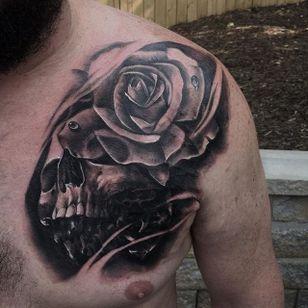 Black and grey skull and rose tattoo by JP Alfonso. #blackandgrey #realism #JPAlfonso #skull #rose
