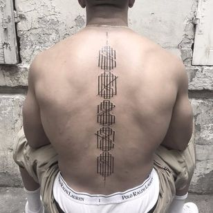 Spine monogram tattoo by Walter Hego #WalterHego #monogram #lettering #linework #calligraphy #ornamental