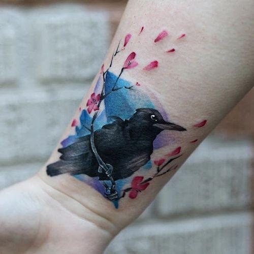 Watercolor brushstroke bird and cherry blossom tattoo by Georgia Grey. #illustrative #sketchy #watercolor #GeorgiaGrey #bird #flower #cherryblossom