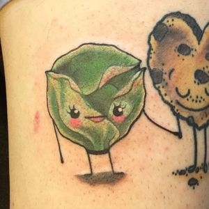 Cute brussels sprout holding hands with a chocolate chip cookie. Tattoo by Hollie West. #traditional #food #cute #cookie #brusselssprout #HollieWest