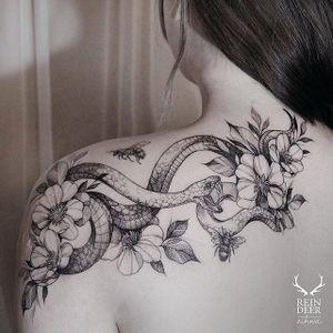 Fine line tattoo by Zihwa. #Zihwa #SouthKorean #SouthKorea #fineline #floral #blackandgrey #flower #snake
