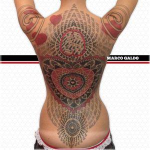 Geometric tattoo by Marco Galdo #MarcoGaldo #geometric #dotwork #redink #geometry #red #black #fullback #hearts