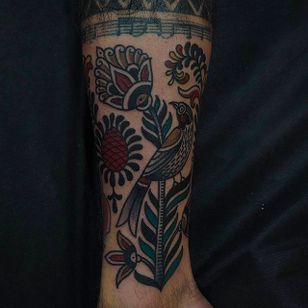 Solid looking leg tattoo of a flower by Or Kantor. #OrKantor #flower #traditional
