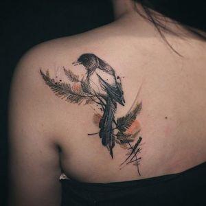 A blackbird perched upon a fern by Nadi (IG—tattooer_nadi). #abstract #blackbird #blackwork #fern #freeform #illustrative #Nadi #watercolor