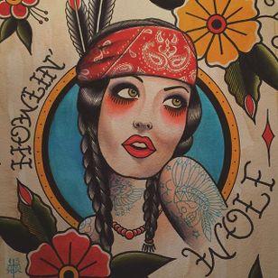 A tattooed Native American lady head design by Howlin' Wolf (IG—howlinwolftattoo). #flashart #ladyhead #HowlinWolf #NativeAmerican #traditional