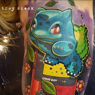 A pixelated Bulbasaur leaping out of a Game Boy Color by Troy Slack (IG—prhymesuspect). #Bulbasaur #GameBoy #Nintendo #Pokémon #TroySlack