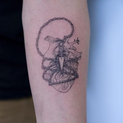 Chained heart tattoo by Oozy #Oozy #hearttattoos #linework #illustrative #detailed #heart #anatomicalheart #love #chain #arrow #blade #knife