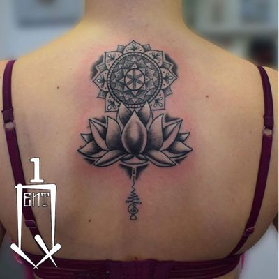 A mandala and lotus atop an Unalome by Quentin (IG—artist.ink_quentin). #blackwork #ornamental #Quentin #Unalome