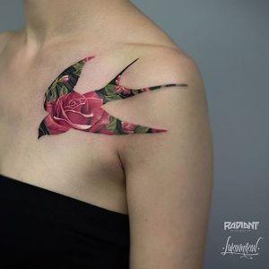 Sparrow shape encapsulates roses, by Andrey Lukovnikov. (via IG—lukovnikovtattoo) #neotraditional #color #silhouette #ukraine #AndreyLukovnikov
