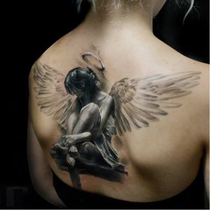 Photo-Realistic Angel Tattoo By Iwan Yug #angeltattoo #IwanYug #photorealistictattoos #realistictattoos #3Dtattoos