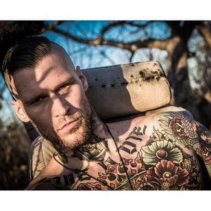 Marshall knows how to charm the camera Photo by The 8th Class #MarshallPerrin #tattoomodel #tattooedguys #firefighter #traditionaltattoo #The8thClass #tattoododudes
