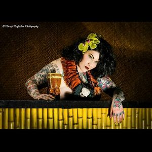 Tiki Style Dallas Valentine photo by Pin-up Perfection Photography #DallasValentine #plusmodel #tattooedbabes #AmericanTraditional #model #pinup #glamor #PinupPerfection #tiki