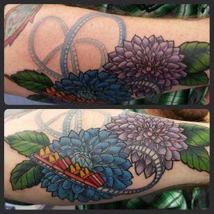 An unusual roller-coaster and dahlia forearm piece by John Lopez. #dahlia #flower #neotraditional #rollercoaster #JohnLopez #floral #dahliaflower