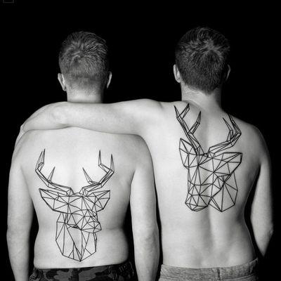 Geometric deer tattoos by Chaim Machlev dots to lines #ChaimMachlev #dotstolines #geometrictattoos #blackwork #linework #deer #antlers #matchingtattoos #tattoooftheday