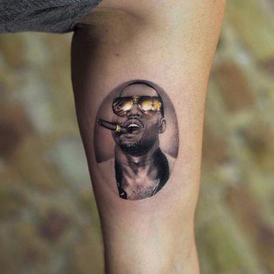 Kanya West tattoo by Jefree Naderali #jefreenaderali #musictattoos #KanyeWest #portrait #realism #realistic #hyperrealism #rapper #music #sunglasses #cigar #gangsta #bling #money #fame #tattoooftheday